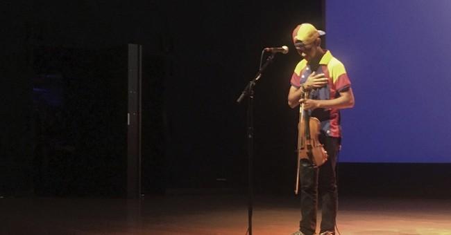 Protesting Venezuelan violinist may seek asylum in US
