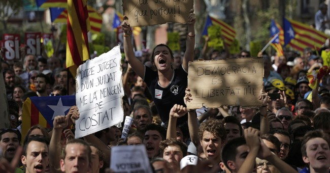 The Latest: Spain hires ferries for more police in Catalonia