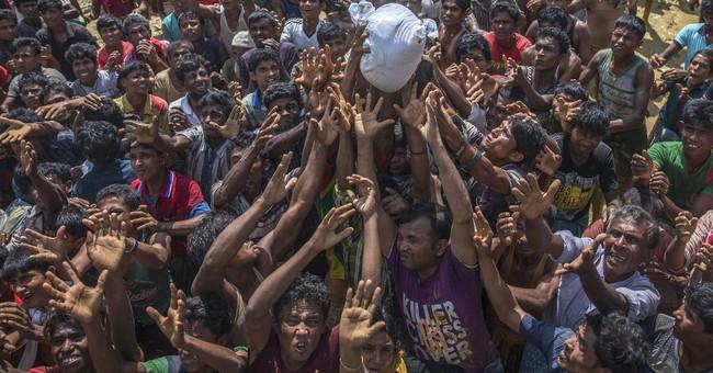 Bangladesh truck carrying Rohingya Muslim aid crashes; 9 die