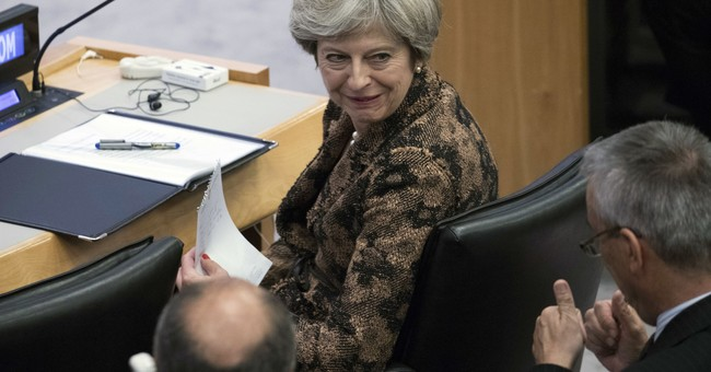 The Latest: EU's Brexit chief welcomes 'constructive' speech