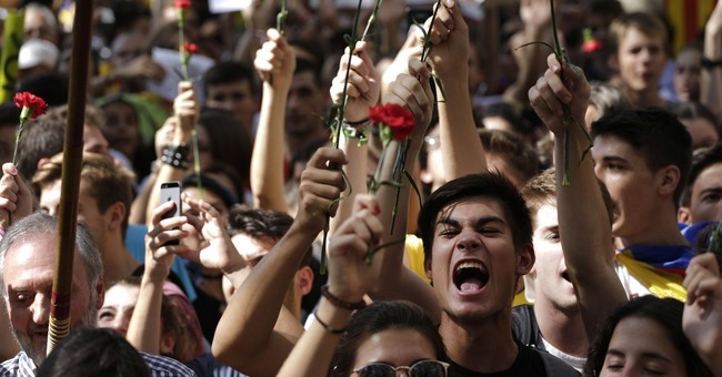 Thousands protest arrests by Spain over Catalonia vote