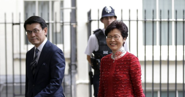 Hong Kong leader condemns UK criticism over jailed activists