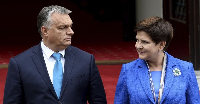 Poland, Hungary leaders persist with anti-migrant policies