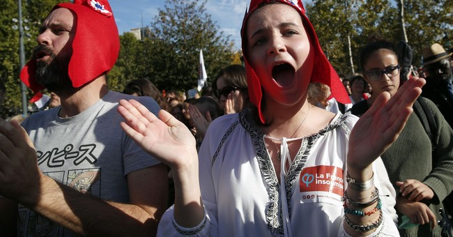 French marchers fill Paris streets to protest new work rules