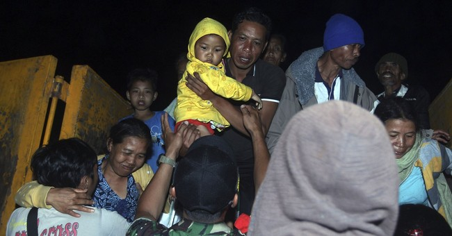 Fearing eruption, thousands in Bali flee from Mount Agung