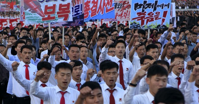 North Korea stages anti-US rally in battle with Trump