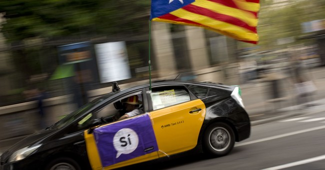 The Latest: Catalonia refuses to give police over to Spain
