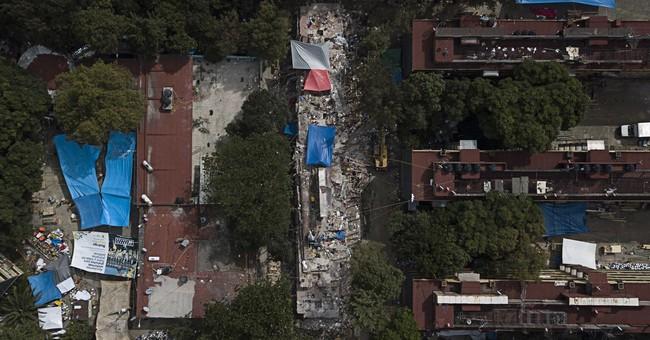 The Latest: After quakes, Mexico volcano spews vapor and ash