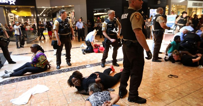 Some forcibly arrested in St. Louis weren't protesting