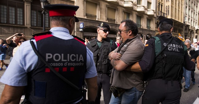Who gives the orders? Spain, Catalonia both claim police