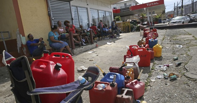 The Latest: Trump notes Puerto Rico devastation _ and debt
