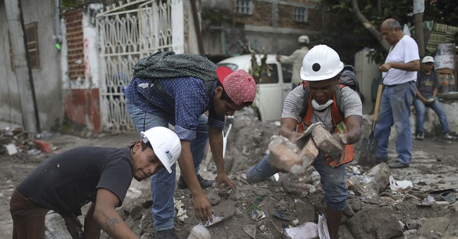 In quake-torn Mexican town, amputee toils to clear debris