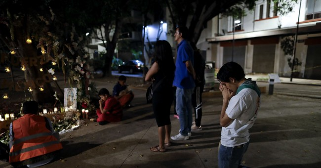 The Latest: Mexico death toll rises to 325