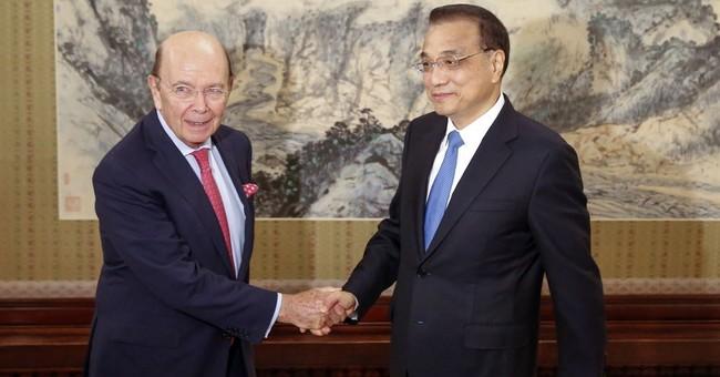 US commerce secretary visits Beijing ahead of Trump trip
