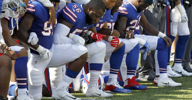 Jim Kelly tempers criticism of NFL player anthem protests