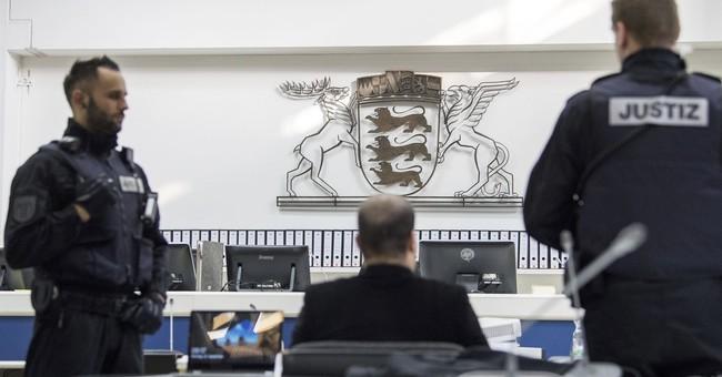 4 men accused of killings in Syria go on trial in Germany