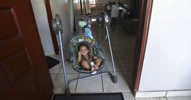 The Latest: Puerto Rico blackout: Many more days in the dark