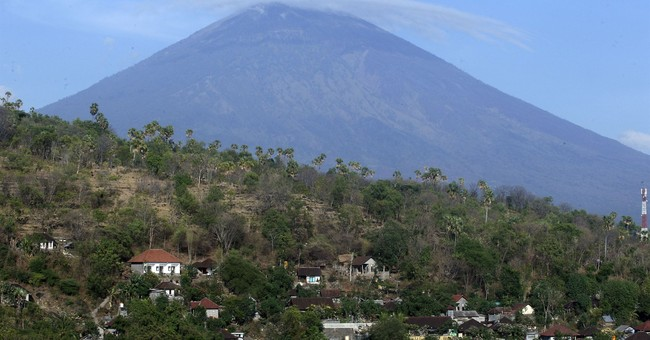 The Latest: Bali volcano fears spark exodus of 75,000