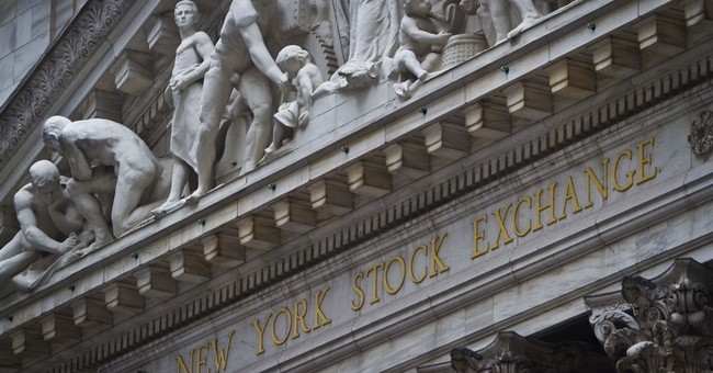 Asian stocks mixed as investors turn focus on US tax reform