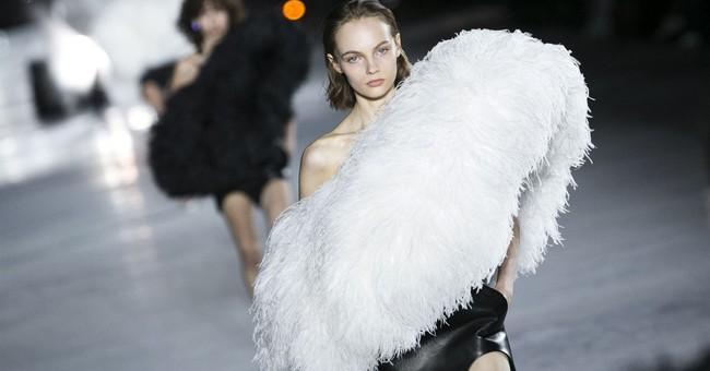 Dior fuses '60s spirit, women's lib at Paris Fashion Week
