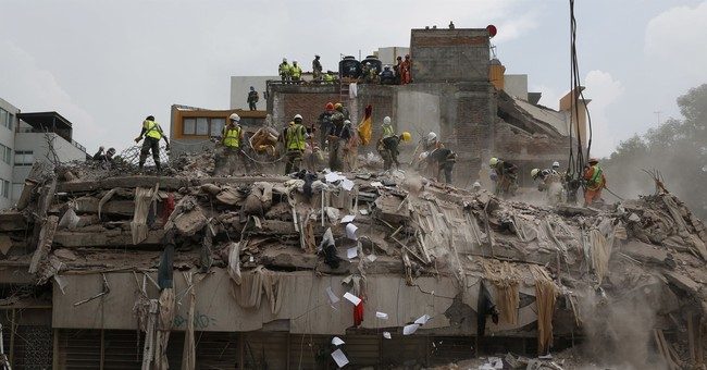 The Latest: Mexico parties offer funds for quake relief