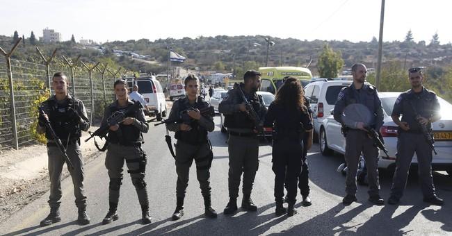 Palestinian kills 3 Israelis outside West Bank settlement