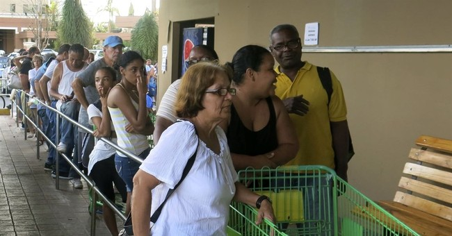 Puerto Rico emerges from storm; water and some food scarce