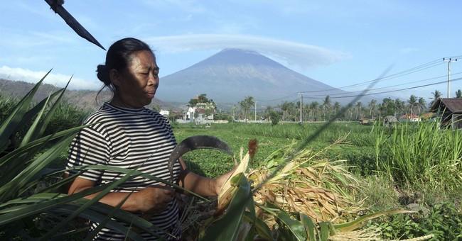 Fears of Bali volcano eruption spark exodus of 75,000