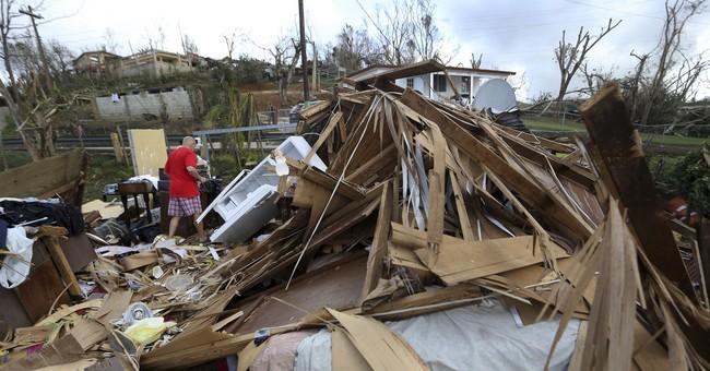 The Latest: Maria, a hurricane again, lashes North Carolina