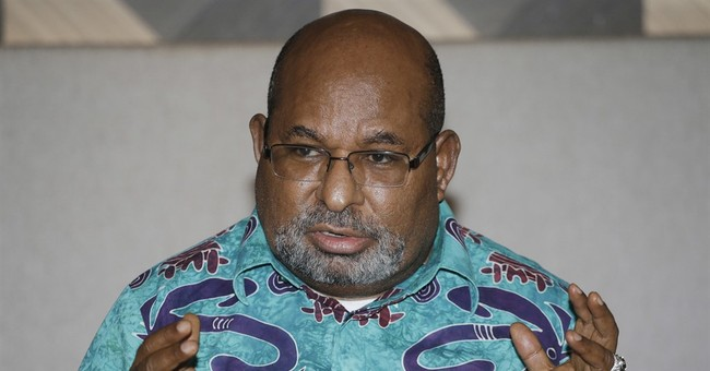 Papua urges US miner to pay $376M in taxes, penalties
