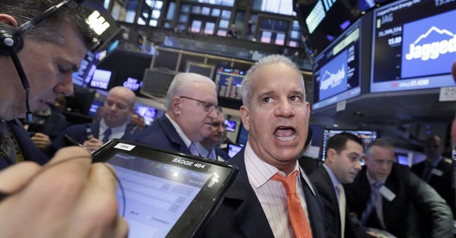 Energy companies lead US stock indexes mostly lower