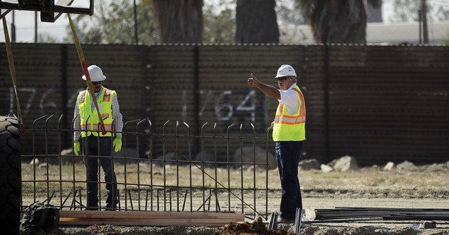 Government gives glimpse of border wall prototype work