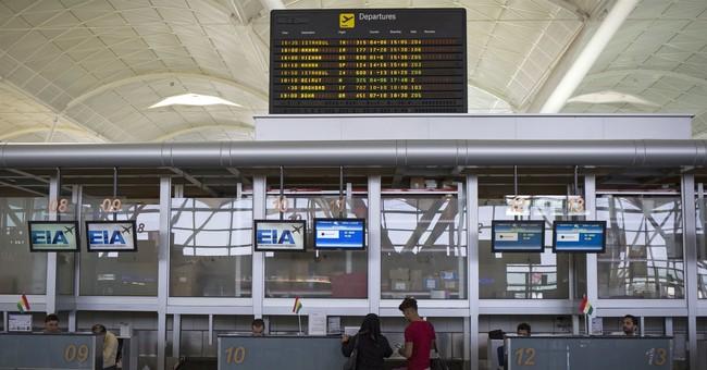 The Latest: Royal Jordanian to halt some Iraq flights