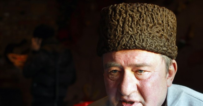 Russian court sends Crimean Tatar leader to prison