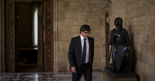 The Latest: Puigdemont says vote crackdown boosting support