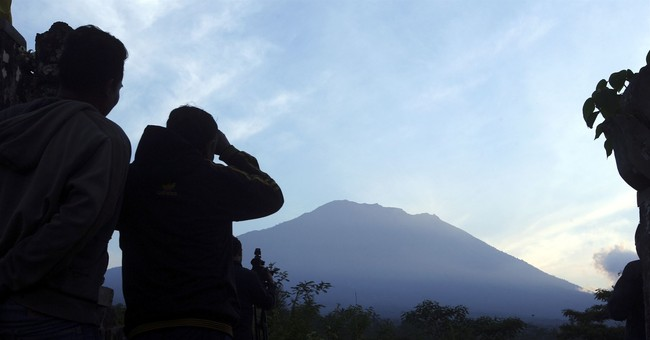 Over 130,000 flee menacing volcano on Bali tourist island