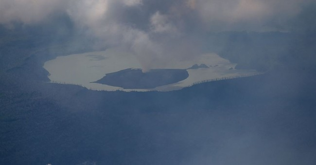 Belching Vanuatu volcano may blow, forces 7,000 to flee