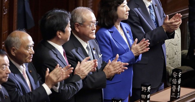 Japan's Abe faces new challenge as he calls snap election