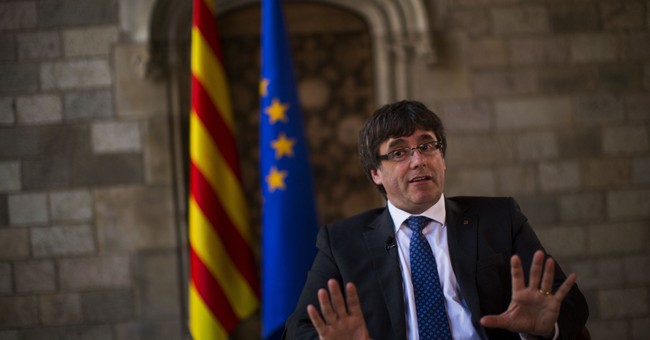 The Latest: Catalan officials aim for peaceful referendum