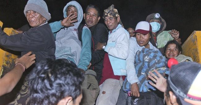 AP PHOTOS: Warnings of Bali volcano eruption spark exodus