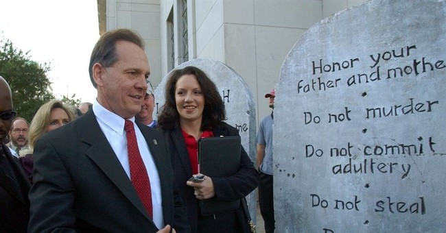 Moore's path to victory in Alabama: God, guns and defiance