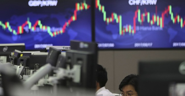 Asian stocks mixed as investors gauge impact of US tax plan