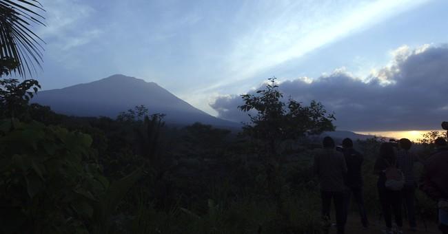 Over 130,000 flee menacing volcano on Bali tourist island
