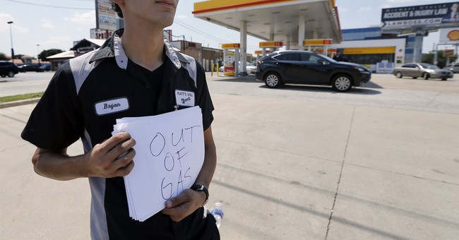 APNewsBreak: Texas' oil regulator took vacation amid Harvey