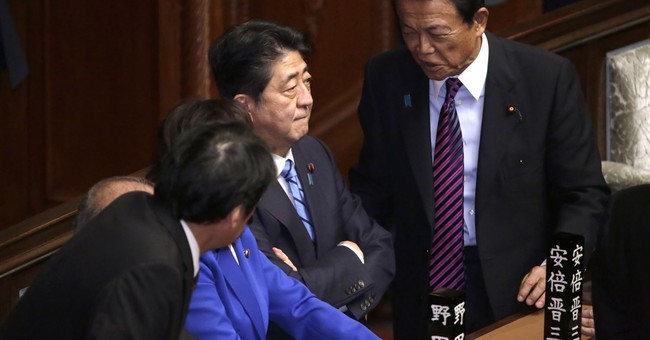 The Latest: Japan PM takes to street seeking voters' support