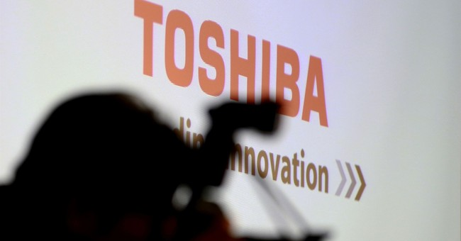 Troubled Toshiba, Bain finalize sale of memory-chip business