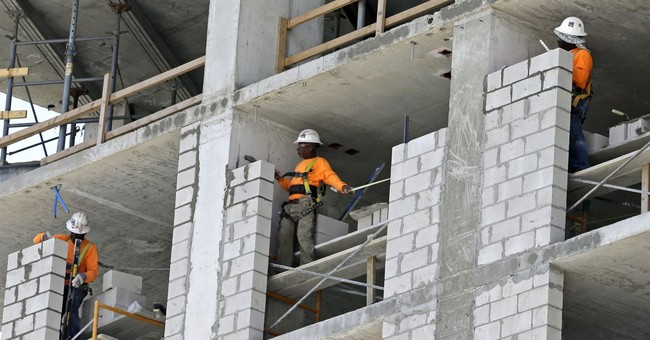 US economic growth revised up to 3.1 percent rate in Q2