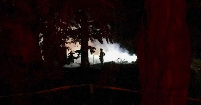 Idaho house burns after police fire shots at home invader
