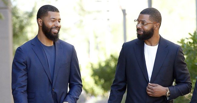 NBA twins miss start of training camp while standing trial