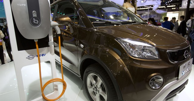 China sets target for electric car quota but delays rollout